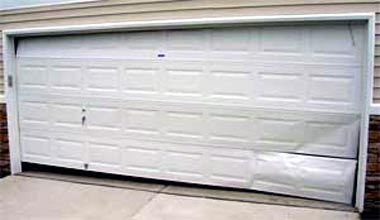 how to fix bent garage door